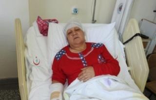 Tartıştığı eşini baltayla yaraladı